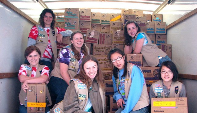 Group of Girl Scouts with their Girl Scout Cookies